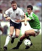 [ image: Quinn takes on England's David Batty back in 1990]