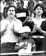 image: Escobar, his wife and son pictured at a soccer match]