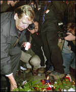 [ image: Vaclav Havel lays flowers at the site of the crackdown 10 years ago]