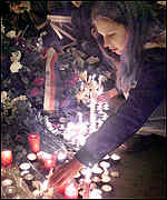 [ image: Candles were placed at the spot where the Velvet Revolution began]