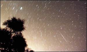 A meteor streaks across the starry sky over the Dead Sea