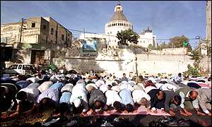 Muslims pray at the site beneath the Basilica of the Annunciation