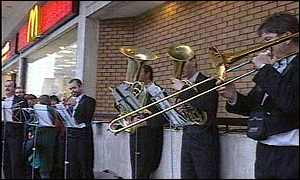 The orchestra outside McDonald's in Swansea