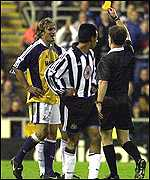 David Ginola is shown the yellow card