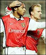 Thierry Henry is congratulated by Dennis Bergkamp