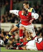 Emmanuel Petit of Arsenal tussles with Seth Johnson