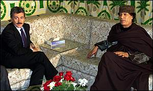 Prime Minister Massimo D'Alema of Italy and Colonel Muammar Gaddafi of Libya.