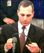 Louis Freeh at a press conference at the grave site