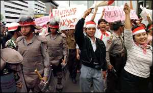 image: [ Indonesian protestors march against rising food prices ]