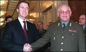 image: [ Cohen (left) and Sergeyev: the smiles belie the tension between the two countries ]