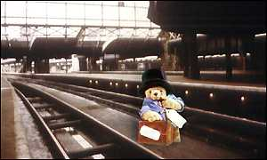 image: [ Paddington Bear in the station which gave him his name ]