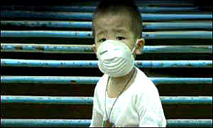 image: [ The smog last year caused breathing problems for many children and old people ]