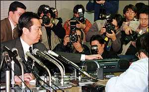 image: [ Liberal Democratic Party lawmaker Shokei Arai, left, speaks to the press about the alleged scandal. ]