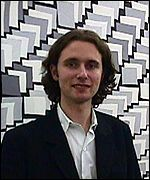 [ image: Artist Peter Davies in front of one of his works]