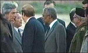 image: [ Kofi Annan is greeted by a top level Iraqi delegation ]