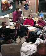 Mission control waits for a signal anxiously