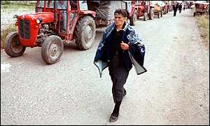 A Serb woman walking out of Kosovo