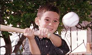 Elian Gonzalez swings his birthday baseball bat