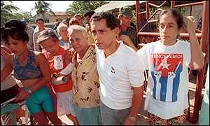 Juan Miguel Gonzalez, second from right, Elian's father