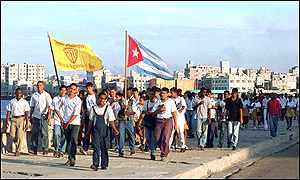 Demonstrators march down Malecon Avenue in Havana