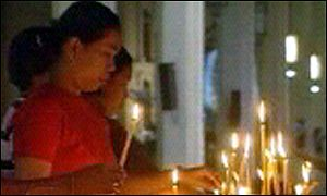 catholic worshipper with candles