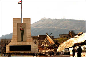 A Syrian flag flutters in a deserted town in the Golan Heights