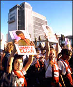 Children hold pictures of Elian aloft