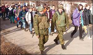 Kosovo Serbs under escort