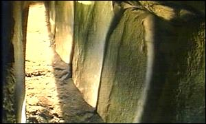 Shaft of sunlight penetrates the Newgrange passageway