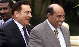 Presidents Mubarak and Bashir enjoy a joke