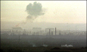 A pall of smoke gathers over Grozny as Russia launches an all-out attack