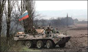 Russian soldiers on an APC outside Grozny