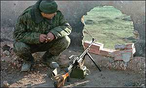 A Russian guard watches the area on the outskirts of Grozny