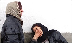 A Chechen woman, right, learns of her husband's death