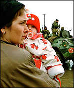 Chechen refugees watch Russian troops entering Chechnya