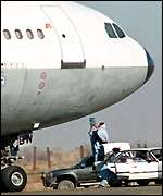 Taleban man passes water to plane