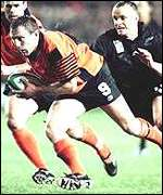 Gary Armstrong is tackled by Christian Cullen