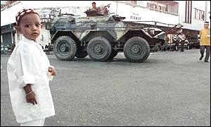 Child and armoured vehicle in Ambon