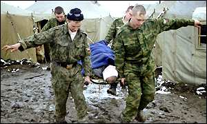 Russian soldiers carry wounded colleague