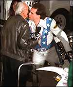 [ image: A kiss for dad before the dangerous deed]