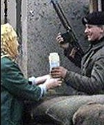 [ image: A British soldier accepts a welcome flask of tea]