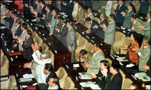image: [ The People's Consultative Assembly applauds the swearing-in of Suharto ]
