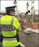 Police officer on quayside