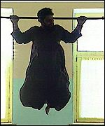 Working out: An Afghan man does chin-ups