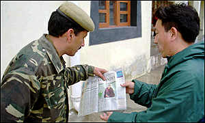 Guard with newspaper