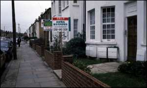 Street with For Sale signs