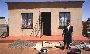 Woman outside township house
