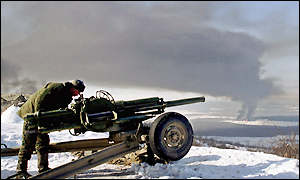 A Russian soldier aims a cannon at targets in Grozny
