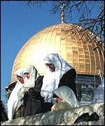 Palestinian women pray at the al-Aqsa Mosque