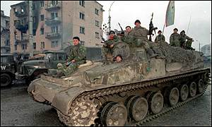 russian soldiers patrolling Grozny